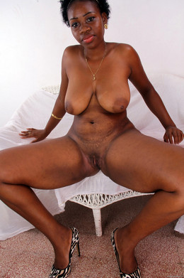 Big titted black MILF with thick hips..