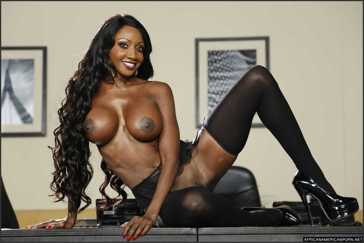 Description: Busty black pornstar Diamond Jackson posing just in black  stockings